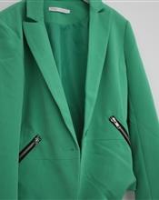 Grønn dressjakk..